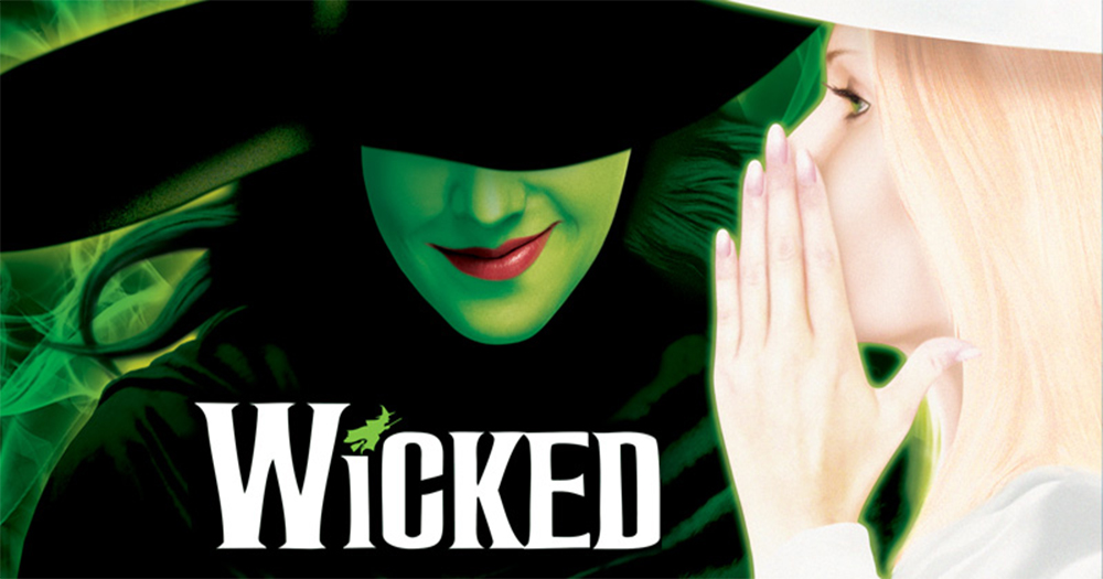 Poster for the stage show Wicked with an animated Glinda the Good Witch whispering in the ear of Elpheba, a green skinned Wicked Witch