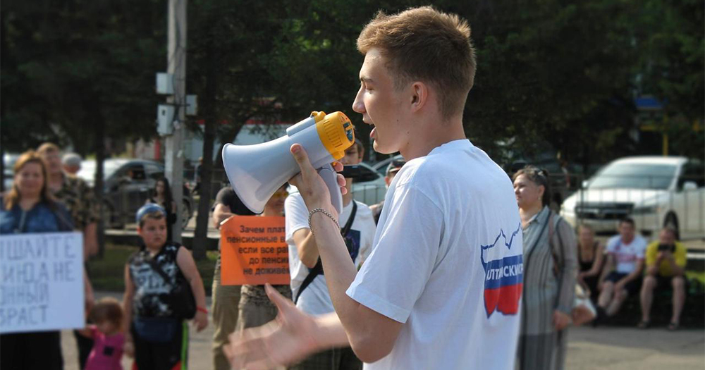 Maxim Neverov who was found guilty under Russia's gay propaganda laws speaking on a megaphone to an assembled crowd