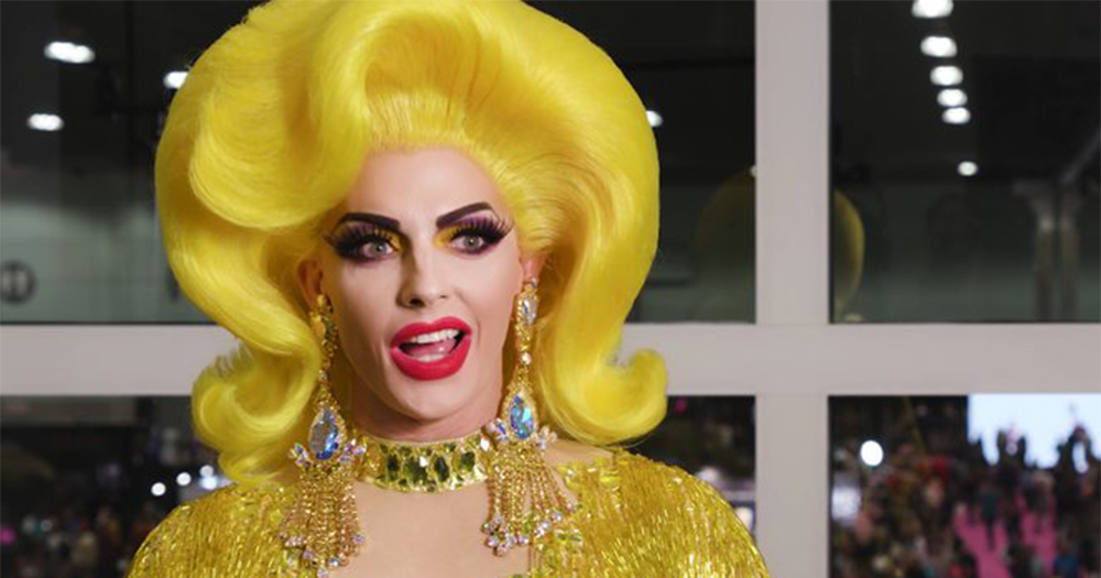 Drag queen Alyssa Edwards wears a huge wig and glittering dress