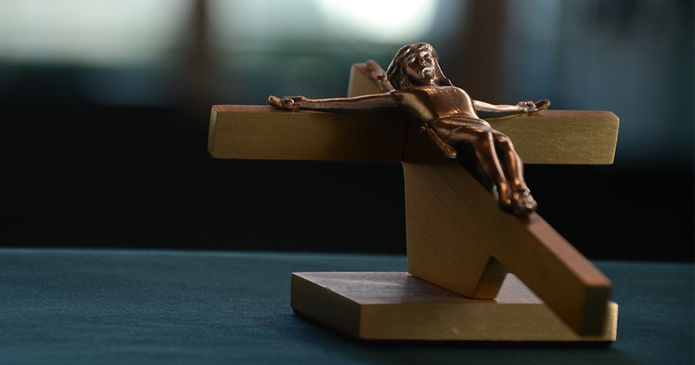 A wooden carving of Jesus on the cross
