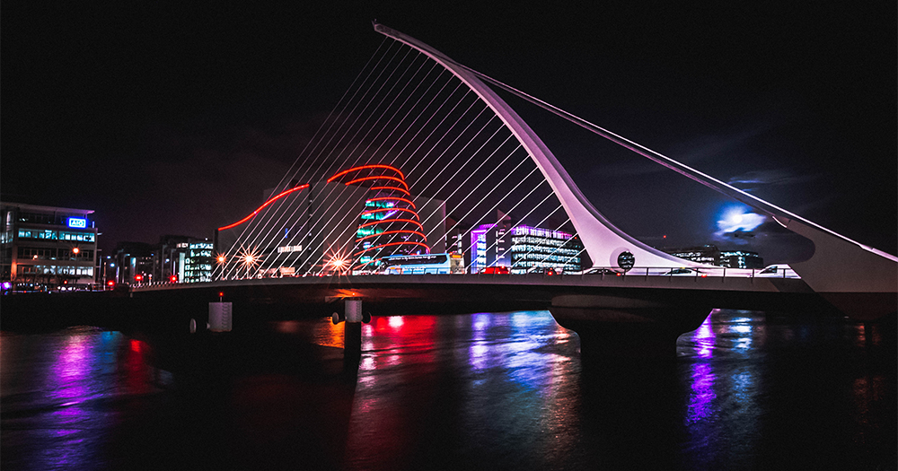 An image to publicise the events website GayToDo of Dublin's Samuel Beckett Bridge at night, the multicoloured lights of the city reflected in the Liffey