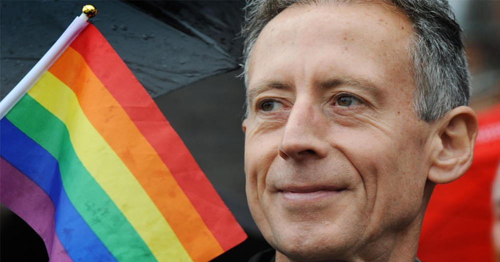 Activist and founder of the eponymous Peter Tatchell Foundation with a rainbow flag to his side