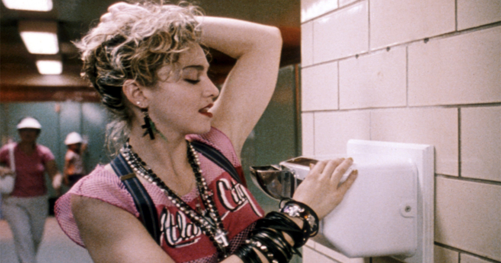 Madonna dries her armpits with a public toilet air dryer in a scene from Desperately Seeking Susan