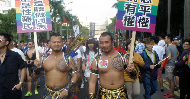 A pair of topless male marchers at Malaysia Pride