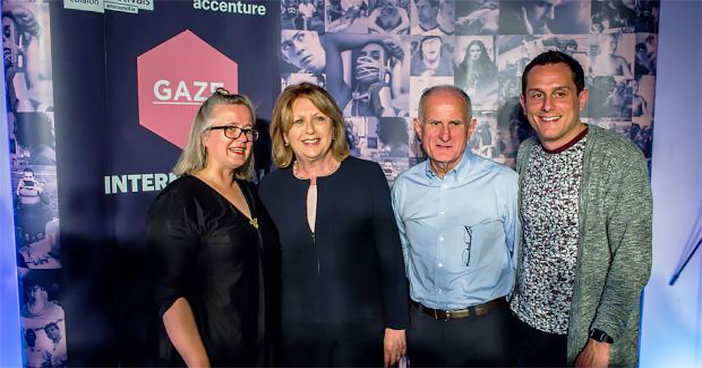 In front of posters for the Gaze LGBT Film Festival stand Chairperson Sarah Williams, Mary McAleese, her husband Martin and her son Justin