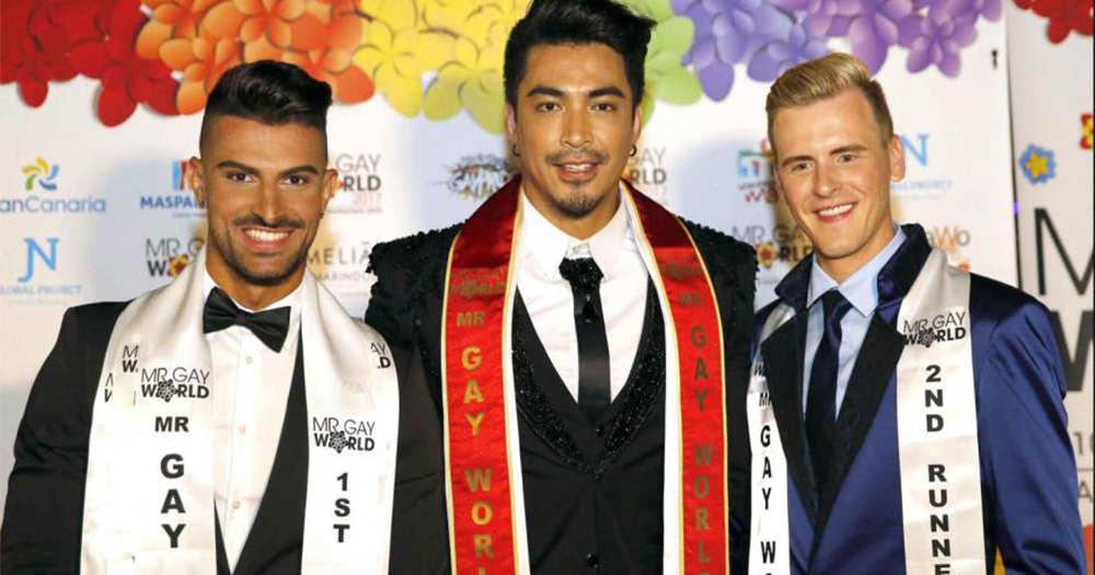 The three finalists of Mr Gay World 2017 all wearing suits and sashes