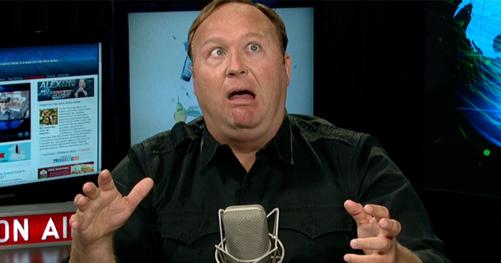 Radio host Alex Jones pulling a funny face while sitting in his recording studio