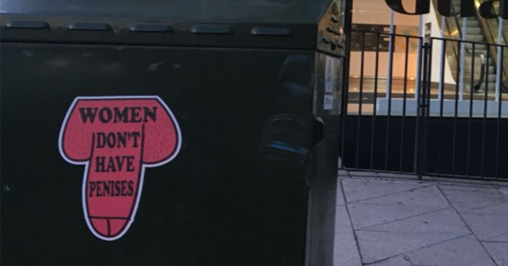 Phallic shaped stickers on a postbox which reads 'women don't have penises'