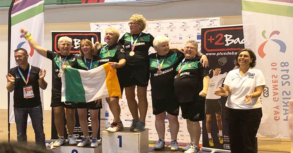 hree of the Team Ireland badminton teams standing on the podium after winning gold, silver and bronze at the Gay Games