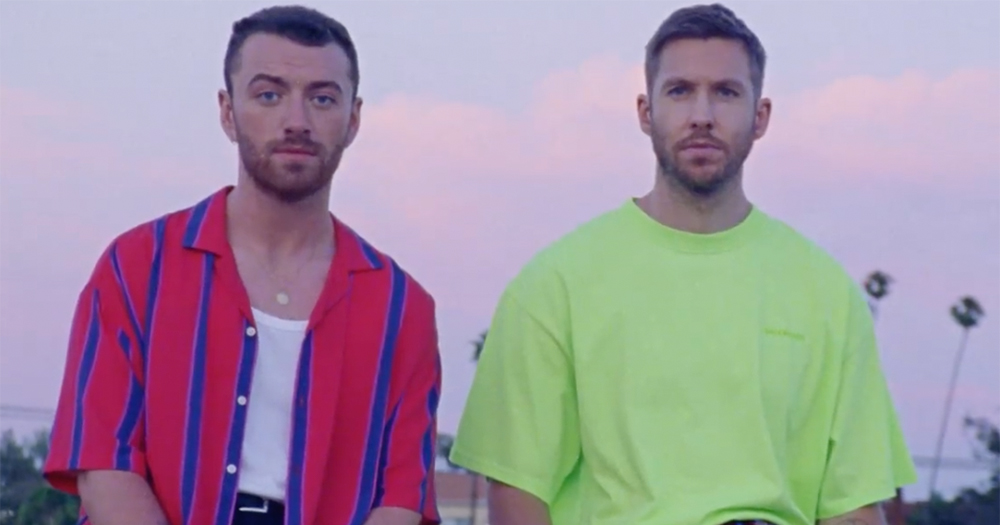 Sam Smith and Calvin Harris sit side by side the sun setting in the background