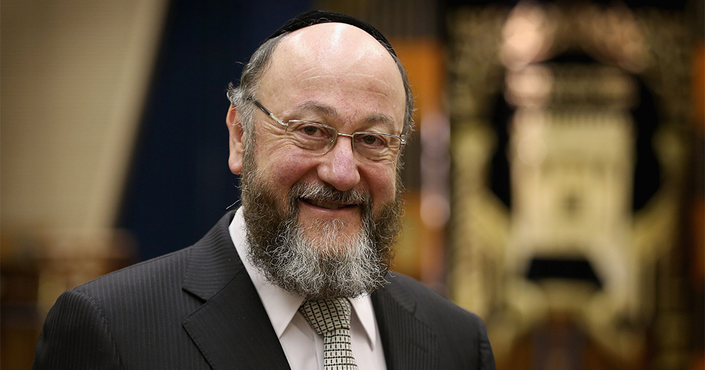 Chief rabbi Ephraim Mirvis smiles at the camera