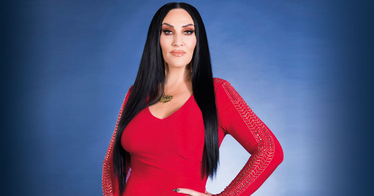 Image of Michelle Visage in red dress facing front.