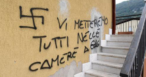 A neo-nazi graffiti outside the house of the victim of the homophobic attack in Verona