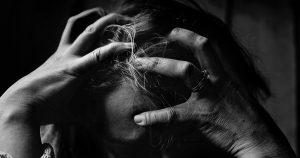 Image of a stressed person. The Australian report detailed the horror of conversion therapy.