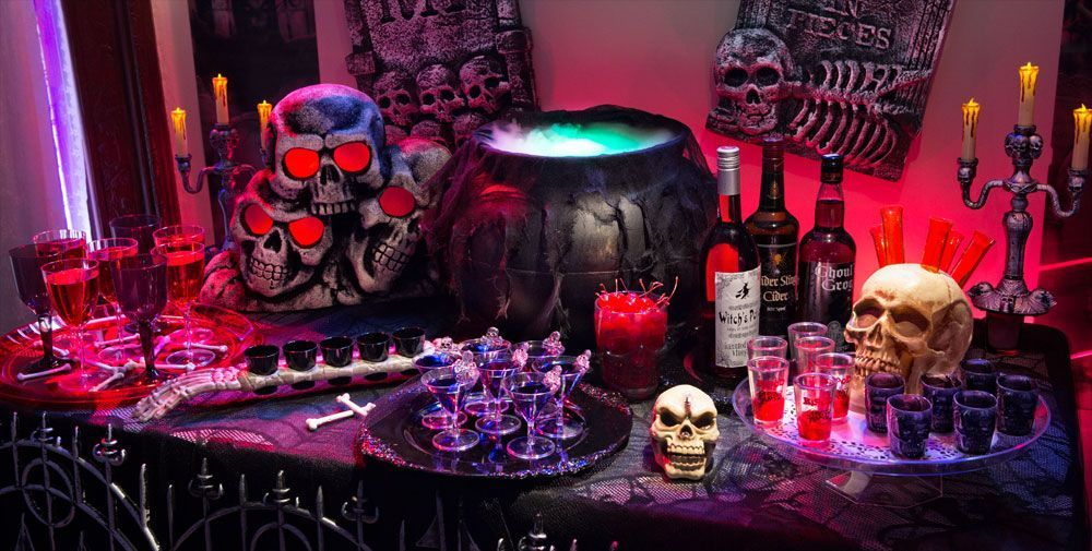 A table full of treats and drinks for an Halloween party