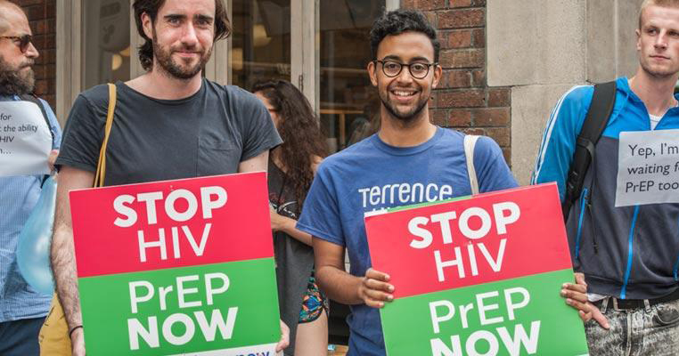 Men from the HIV charity Terrence Higgins Trust hold placards for greater access to PrEP