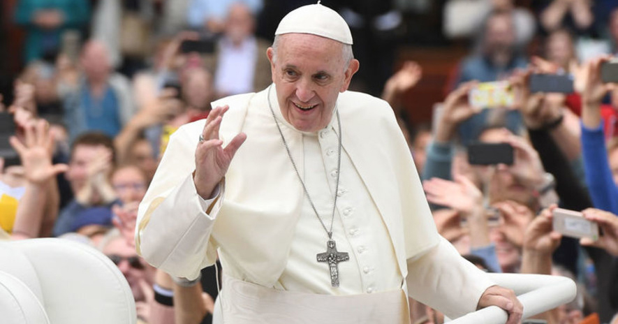 Subject of an Irish poll, Pope Francis waves at crowds during his visit