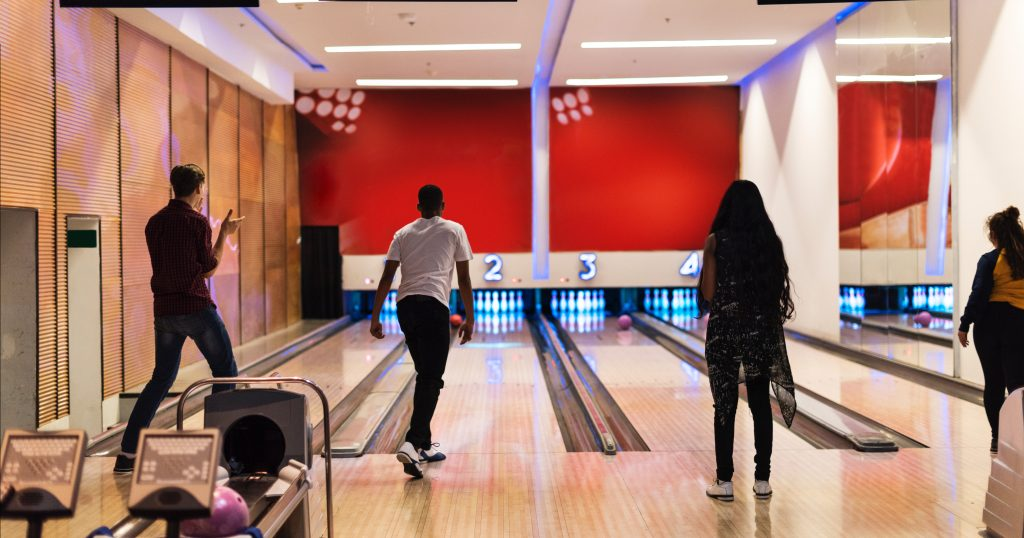 Image of people at a bowling alley.