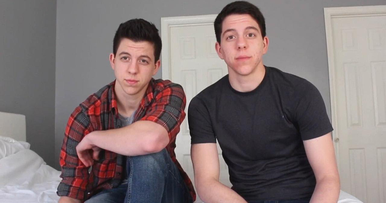 23 year-old twins Jack and Jace Grafe sit in their bedroom speaking to the camera
