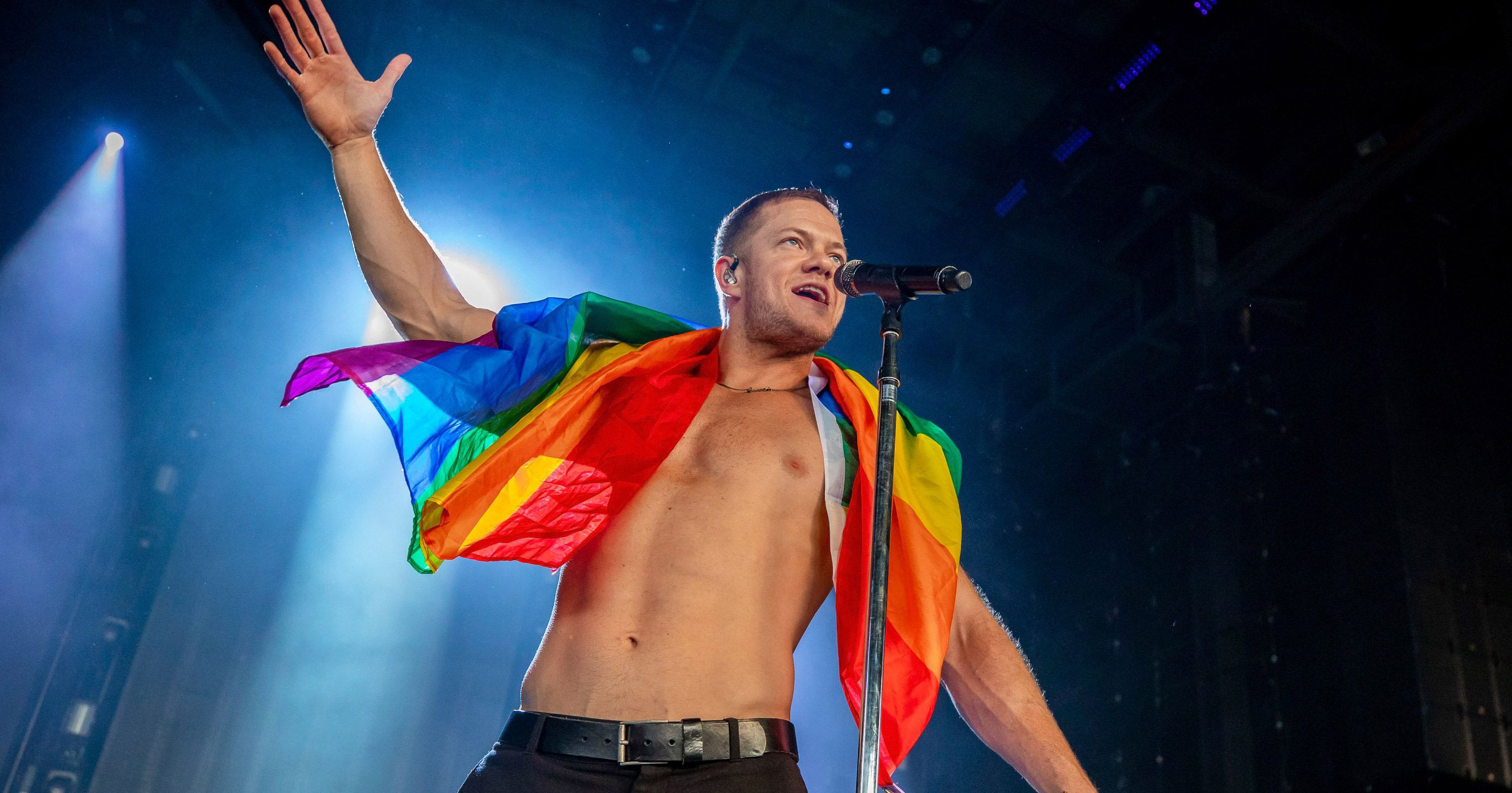 One of the LGBT communities allies, a topless Dan Reynolds draped in a rainbow flag