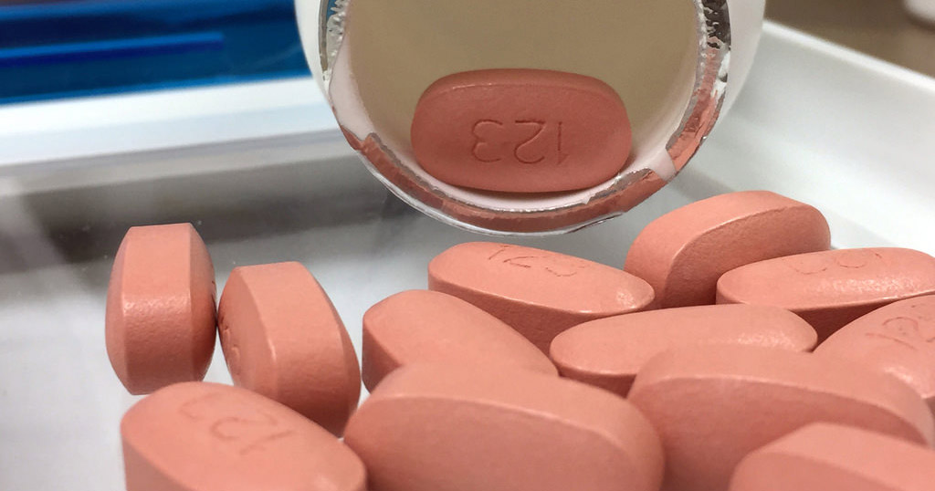 HIV drug spilled out onto a glass table