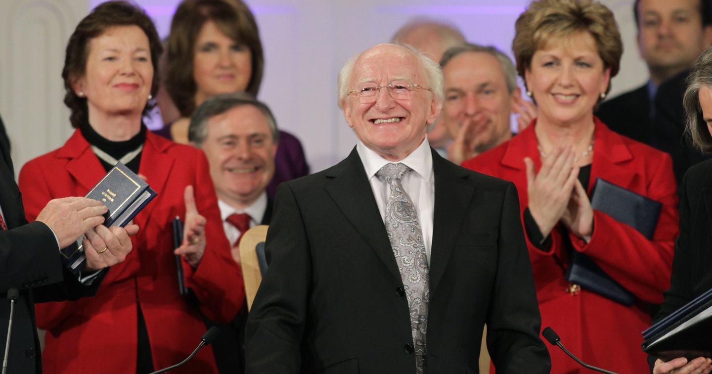Michael D Higgins being sworn into the Presidency of Ireland with Mary McAleese and Mary Robinson in the background