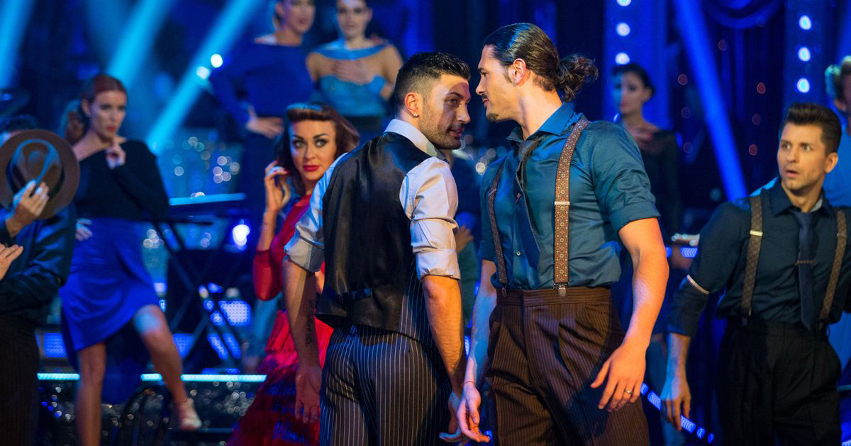 Two male dancers on Strictly Come Dancing looking into each other's eyes during a routine