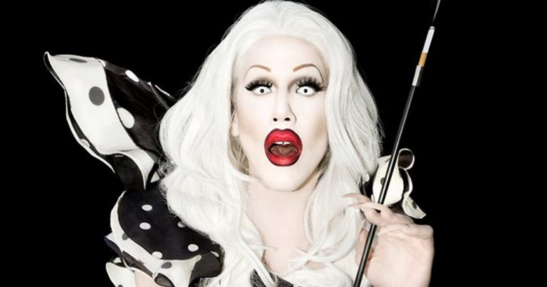 Image of drag queen Sharon Needles with a cigarette holder