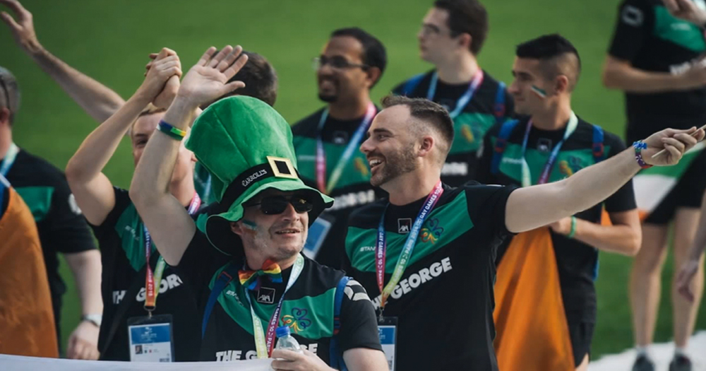 team Ireland at the 2018 Gay Games in Paris, holding the Irish flag during the opening ceremony.