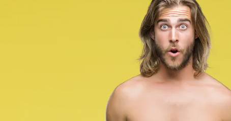 A topless man is shocked