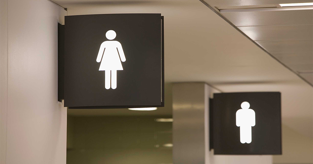 The female and male bathroom symbols over public toilets in a West Virginia school