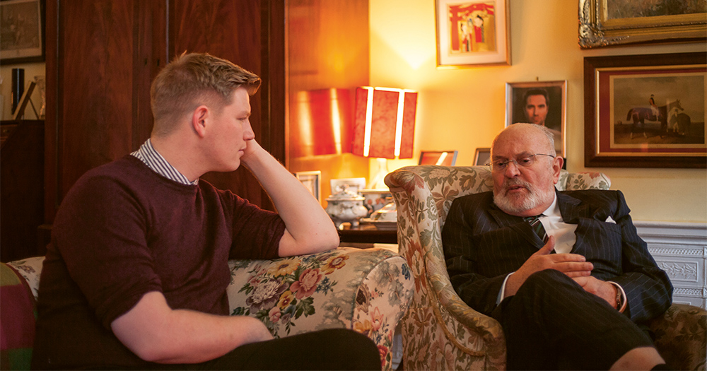 David Norris and Samuel Riggs chat in a cosy sitting room