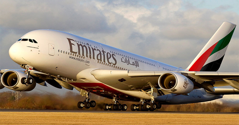 An Emirates flight takes off from the runway
