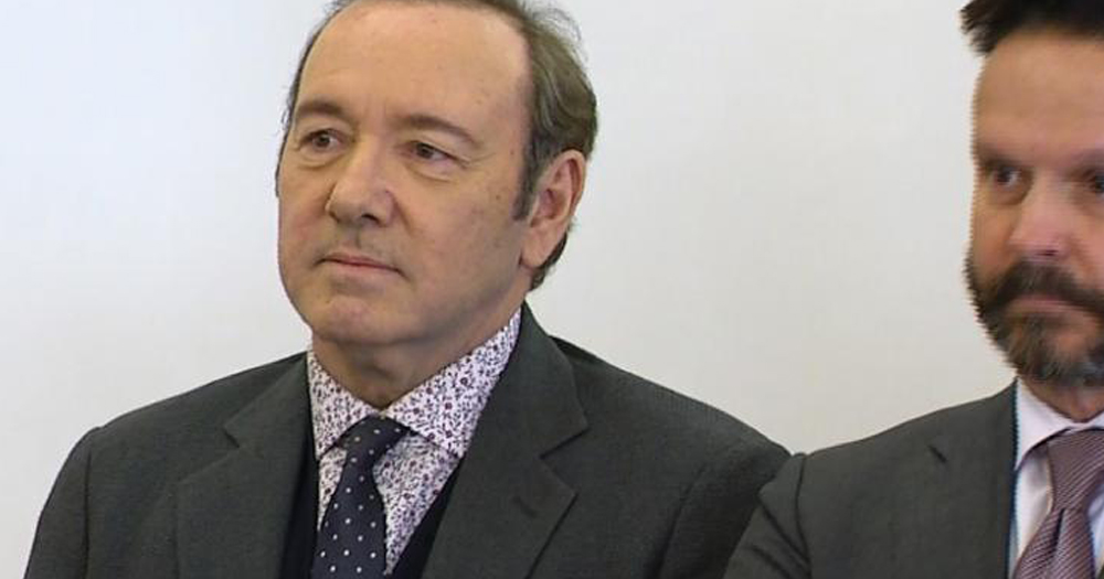 Kevin Spacey sitting in court with a lawyer.