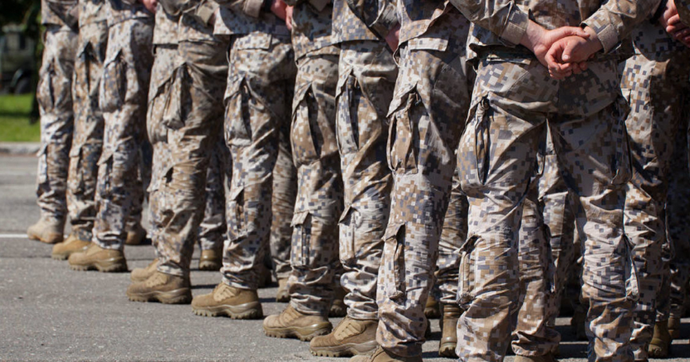 US soldiers stand in a line