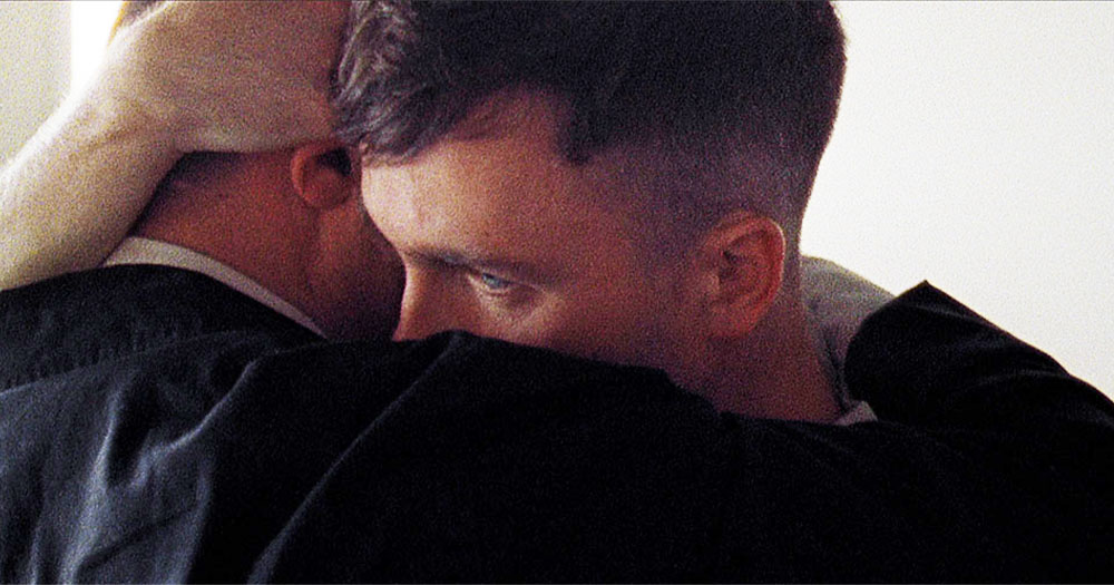 A close up of two men embracing in a still from the short film 'Wren Boys'