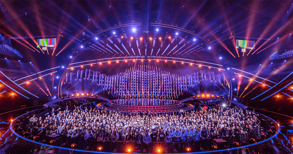 A group photo of the huge crew on the stage of the Eurovision