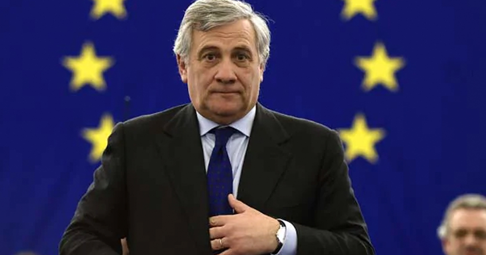 The President of the European Parliament Antonio Tajani in front of the EU flag.