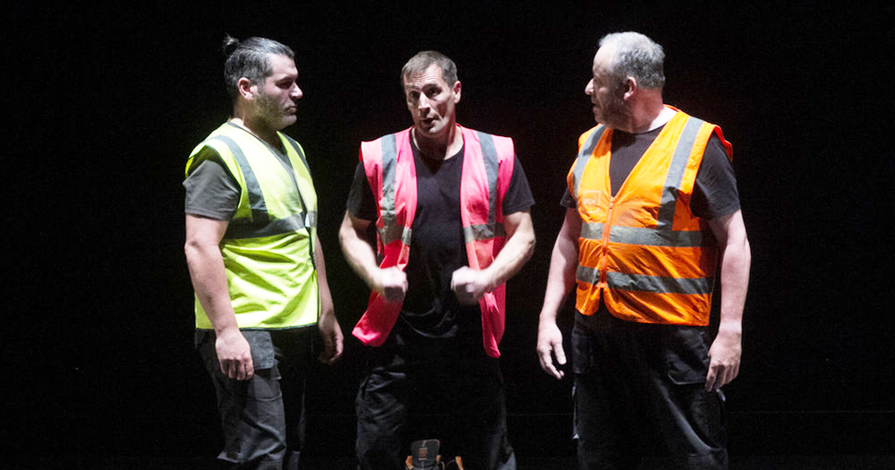 An image from the First Fortnight show Body Of Work featuring three middle aged male builders all wearing different colour high-viz vests