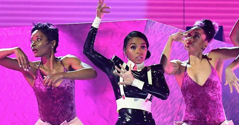 Janelle Monáe performs with backup dancers at the Grammys