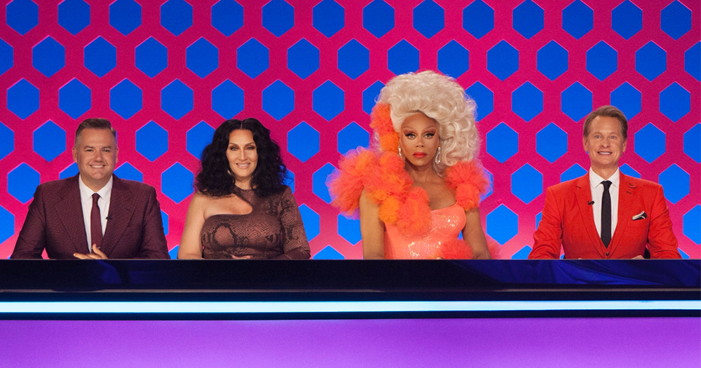 Rupaul and Michelle Visage with the guest judges Carson Kressley and Ross Matthews behind the desk on the set