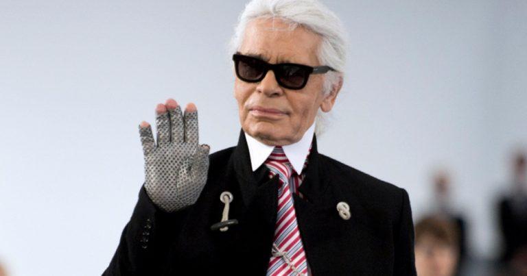 Karl Lagerfeld waving at a camera.