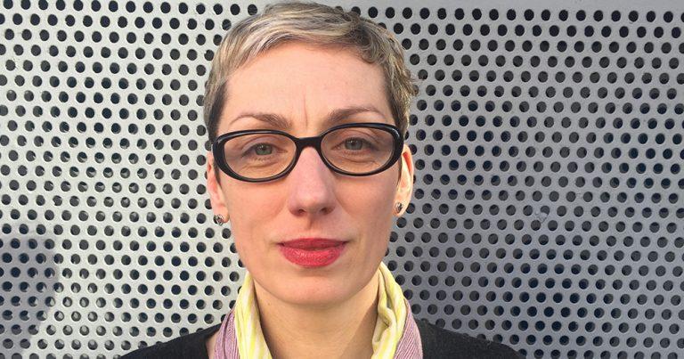 A headshot of Lívia Paldi posing outside the Project Arts Centre