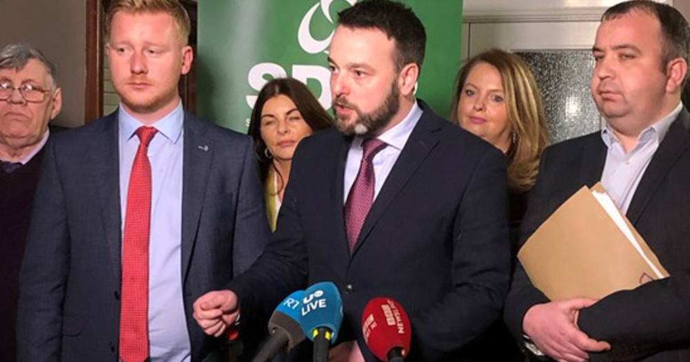 Members of the SDLP speaking at a press conference.