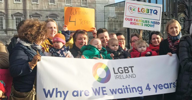 A group of same-sex families and their children protesting outside Leinster house for the state failing to fully protect them