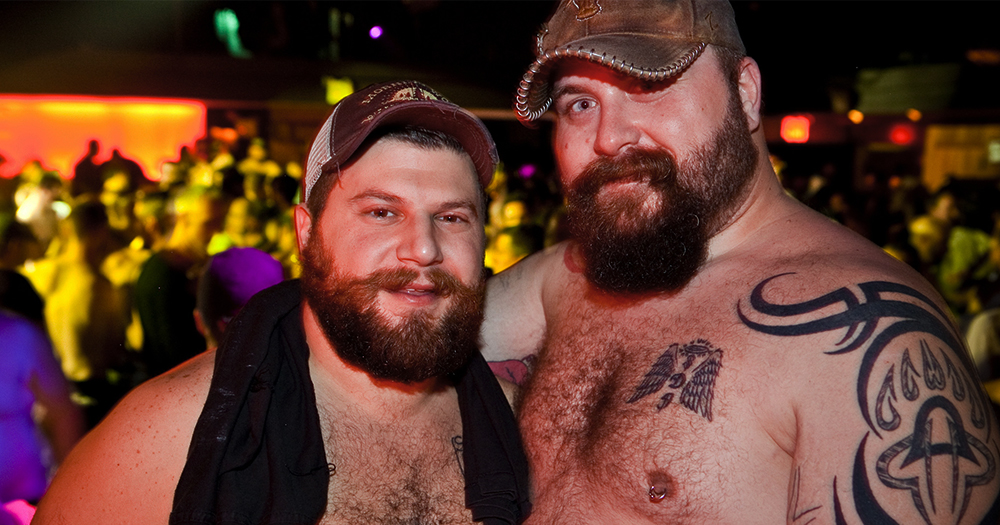 Bear Féile promo image of two topless gay bears in a nightclub