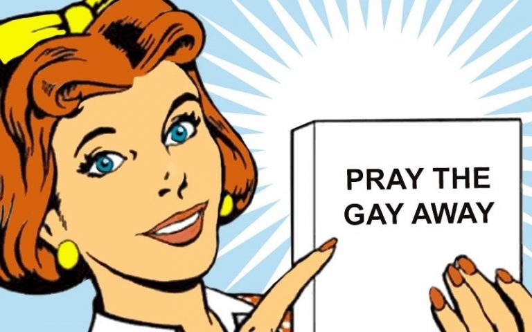 Woman with short orange hair pointing to a book titled 'Pray the Gay Away'