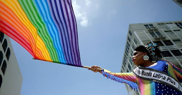 People take part in the annual Gay Pride parade in San Juan, Puerto Rico, on June 3, 2018