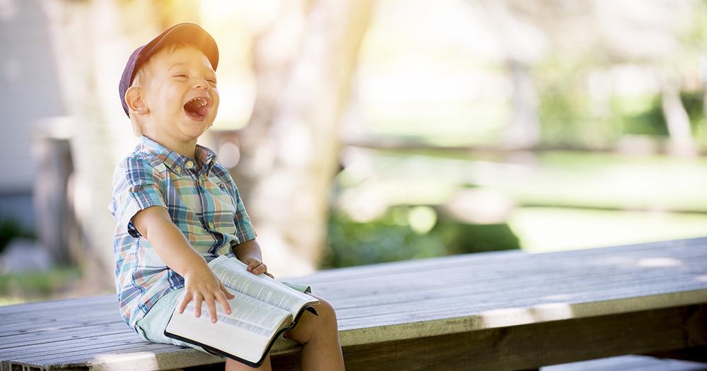 Child reading LGBT+ books
