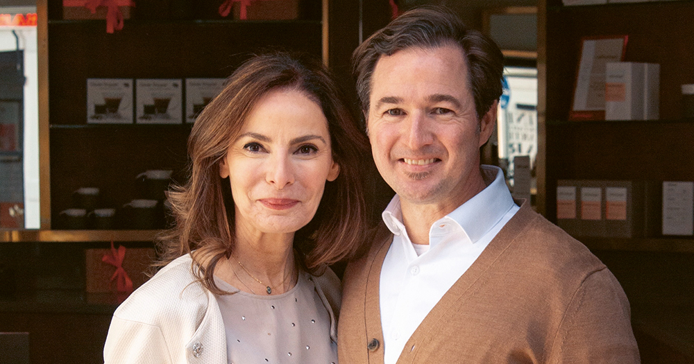 Caroline Sleiman-Purdy and Karl Purdy standing at the entrance to their Coffeeangel business